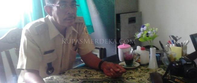 Santoso, Kades Sukaharja, Bogor, yang juga Ketua Paguyuban Linmas Kabupaten Bogor. (dok. KM)