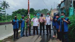 Gerbang disinfektan di Desa Margaluyu, Kecamatan Sukaraja, Kabupaten Sukabumi (dok. KM)