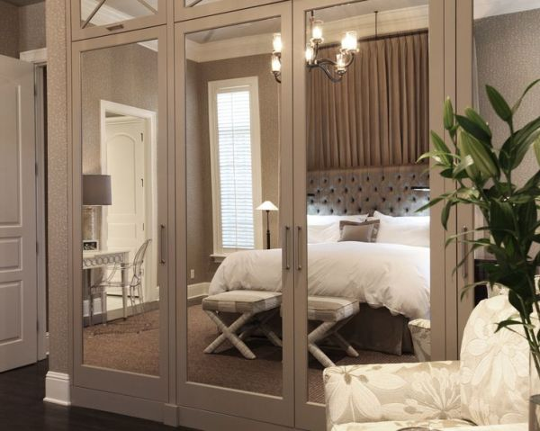Using Simple Bedding and Mirrored Doors. Picture Source: Wolfe Rizor Interiors.