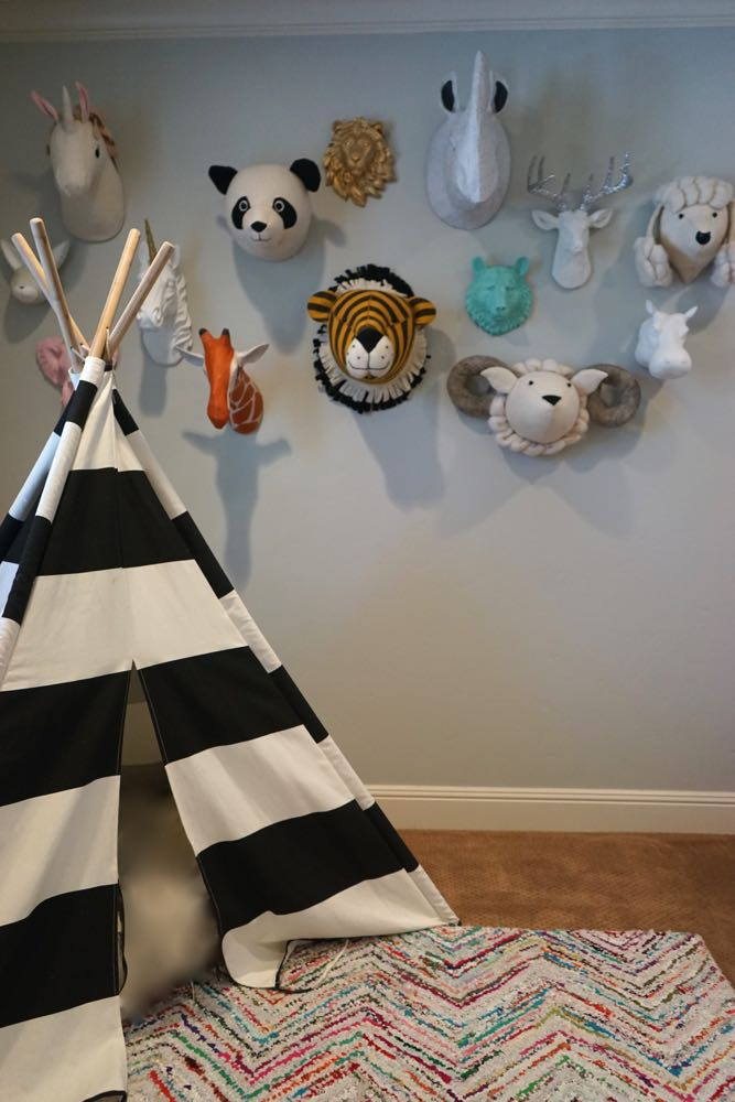 Fun and Kid Friendly Playroom with Reading Teepee from Land of Nod and Animal Wall