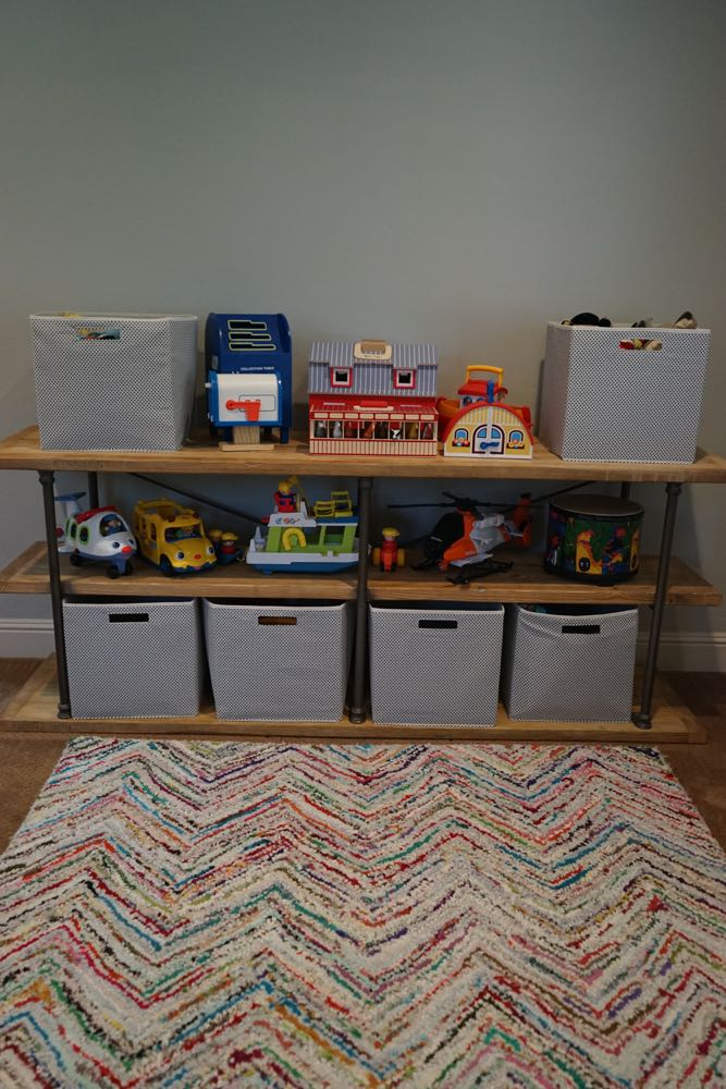 Simple Shelving and Chevron Rug in an Organized Playroom