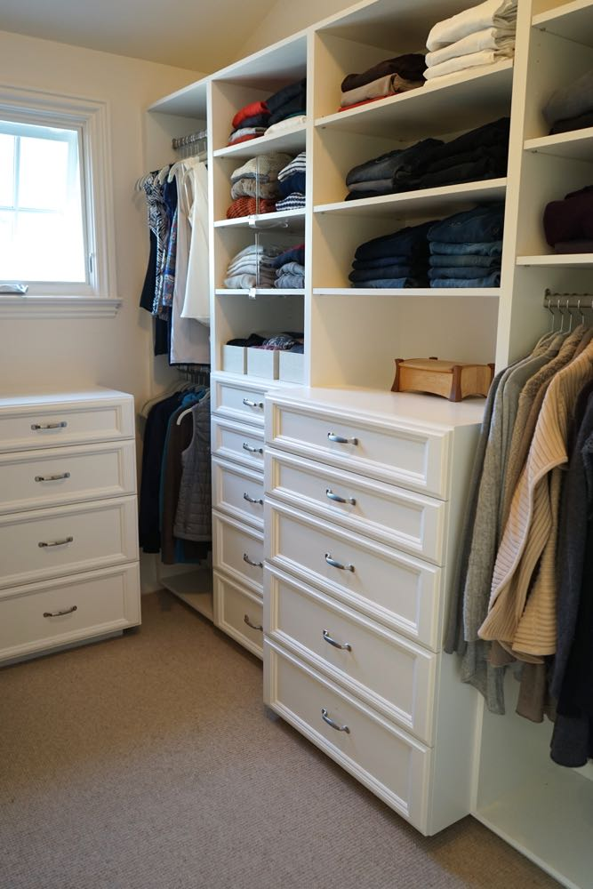 Organized Custom Closet with White Cabinets and Tons of Storage