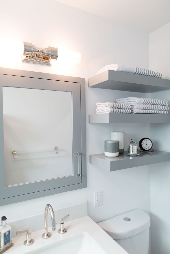 Custom Vanity with storage built into the medicine cabinet and floating shelving for storage and display