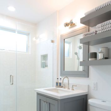 Small but mighty gray and white bathroom with custom vanity and simple design