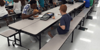 child eating lunch