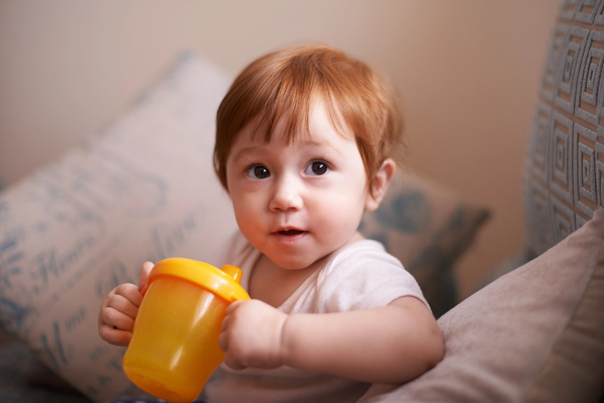 Shot of an adorable baby girl drinking from a sippy cup