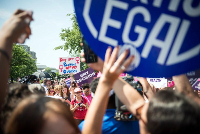 Washington DC, USA - June 27, 2016: Pro-choice supporters cheer in front of the U.S. Supreme Court after the court, in a 5-3 ruling, struck down a Texas abortion access law.
