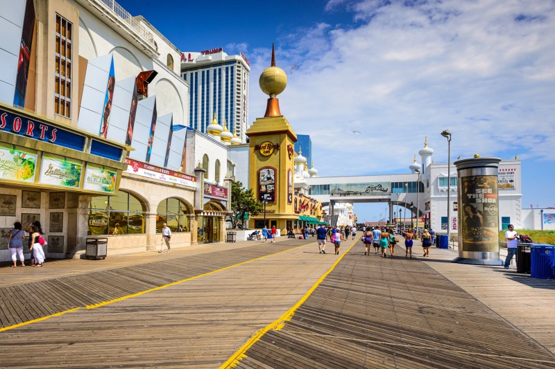 Atlantic City, New Jersey, USA - September 8, 2012: Tourists walk on the boardwalk in Atlantic City. The city is popular for the numerous gambling resorts located there.
