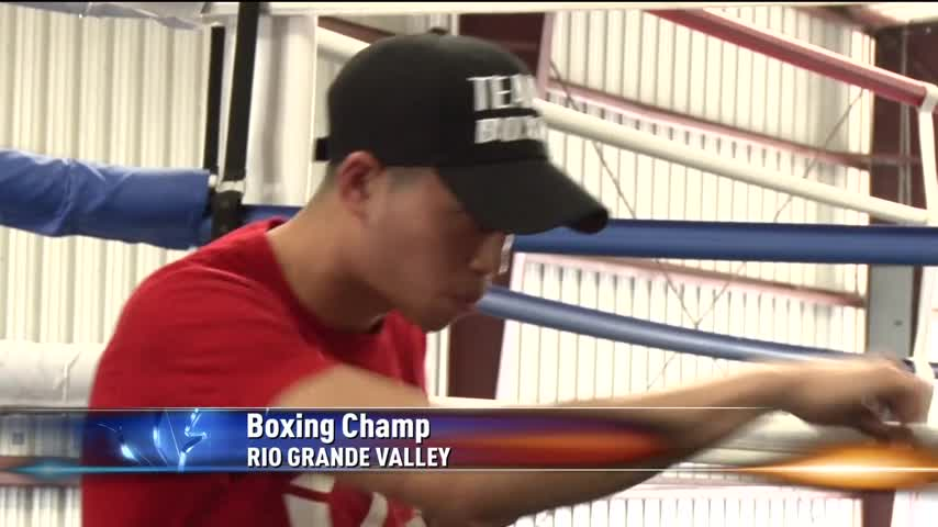 Boxing Champ Visits Home to Help Inspire and Train Children_04265104-159532