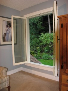 This window is 4 feet wide and 6 feet tall and gives a wonderful view of the garden when both sides are open. An insect screen is mounted on the exterior.