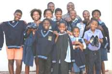 The Diakonia Orphans and Vulnerable Children Project of Adonai Worship Centre received a donation for uniforms from Konstructica Hardware. With the children on the photo is Pastor Tumi, Program director, Pastor David Rangwetsi, Chairperson of the board and mrs Emily Rangwetsi, Managing director of the project.