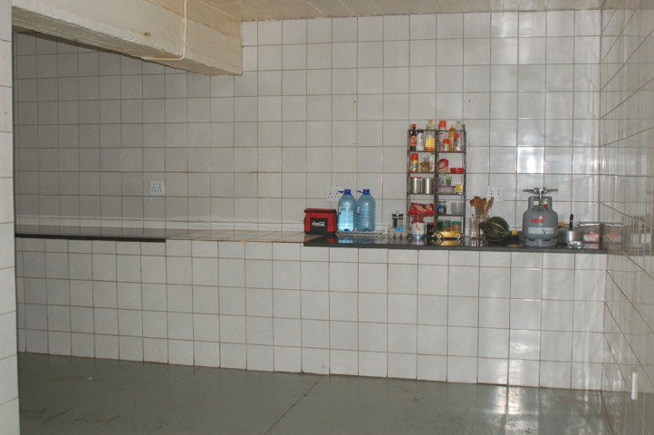 Kitchen prep area with solid granite tops