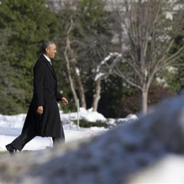 obama President Barack Obama walks past piled snow toward the South Lawn of the White House in Washington, Monday, Jan. 25, 2016, to board Mari_235468