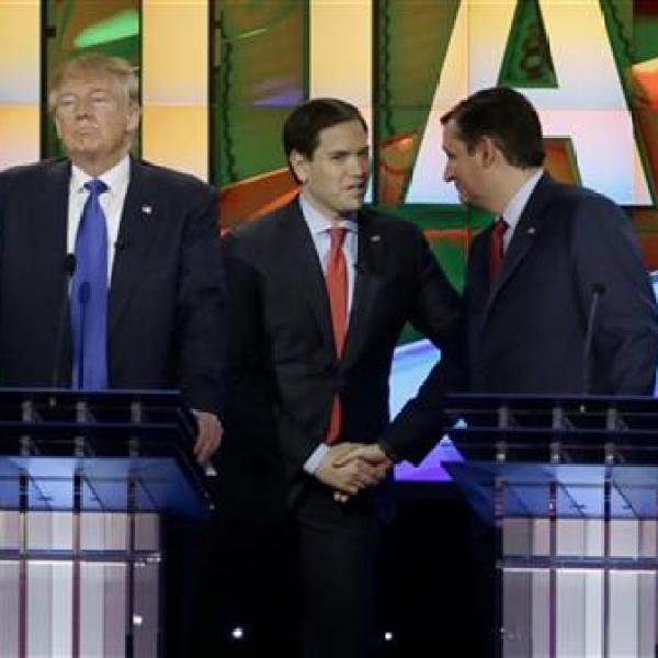 Republican presidential candidate, businessman Donald Trump, pauses as Republican presidential candidate, Sen. Marco Rubio, R-Fla., center and _249818