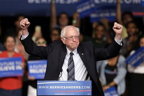 Democratic presidential candidate, Sen. Bernie Sanders, I-Vt. acknowledges his supporters on arrival at a campaign rally, Tuesday, March 8, 201_255482