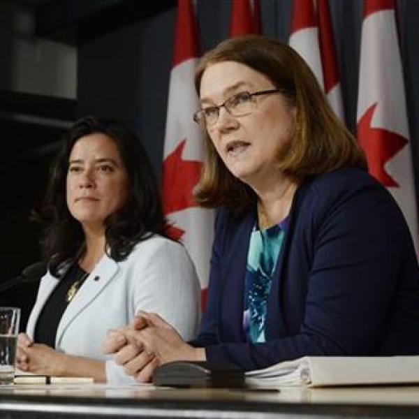 Canada's Health Minister Jane Philpott, right, speaks as Justice Minister Jody Wilson-Raybould listens at a news conference in Ottawa on Thursd_271516