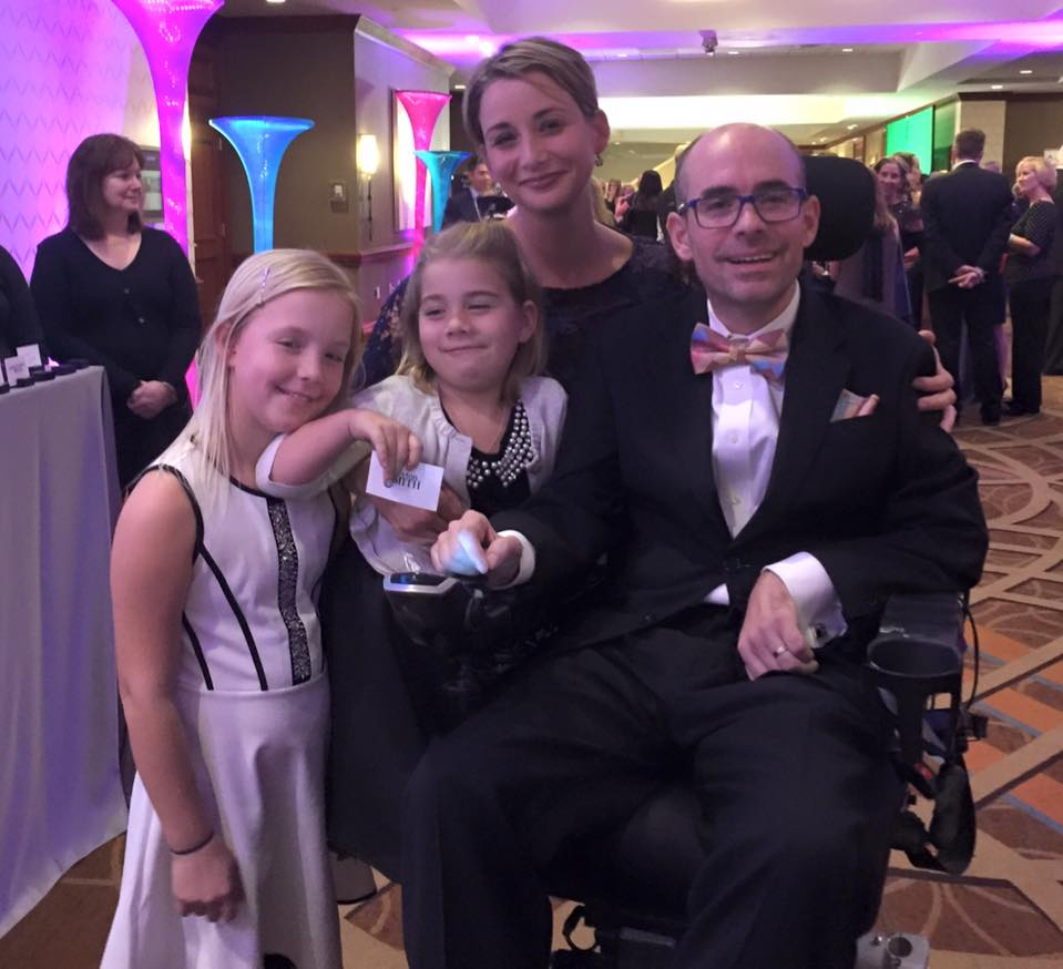 Jay Smith receives an award in Boston, surrounded by his family._304332