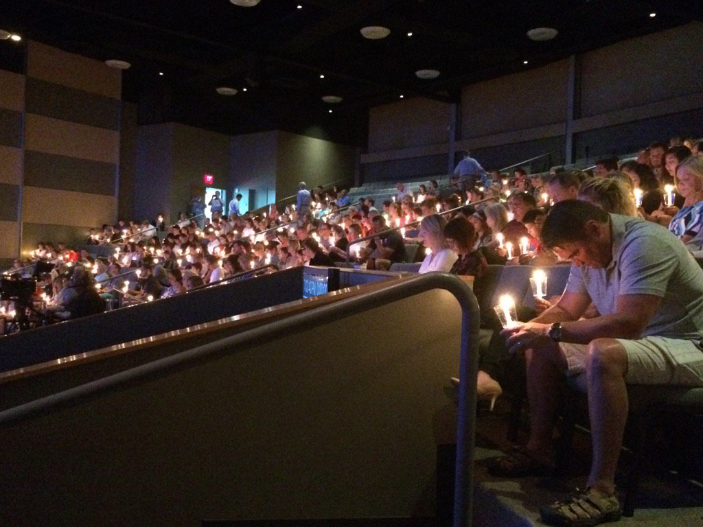 Hundreds gather to honor members of the Copeland family killed in France at a candlelight prayer service Sunday, July 17, 2016._313235