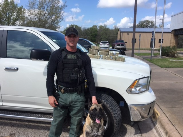 Sgt. Randy Thumann and his K9 partner Lobos of the Fayette County Sheriff's Office find $88,000 in laundered money_432123