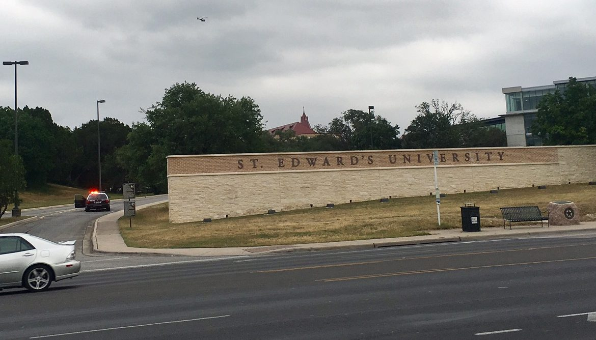 The Austin police helicopter searches for a suspect near St. Edward's University that put the campus on lockdown, May 16, 2017 (KXAN Photo_Todd_472613