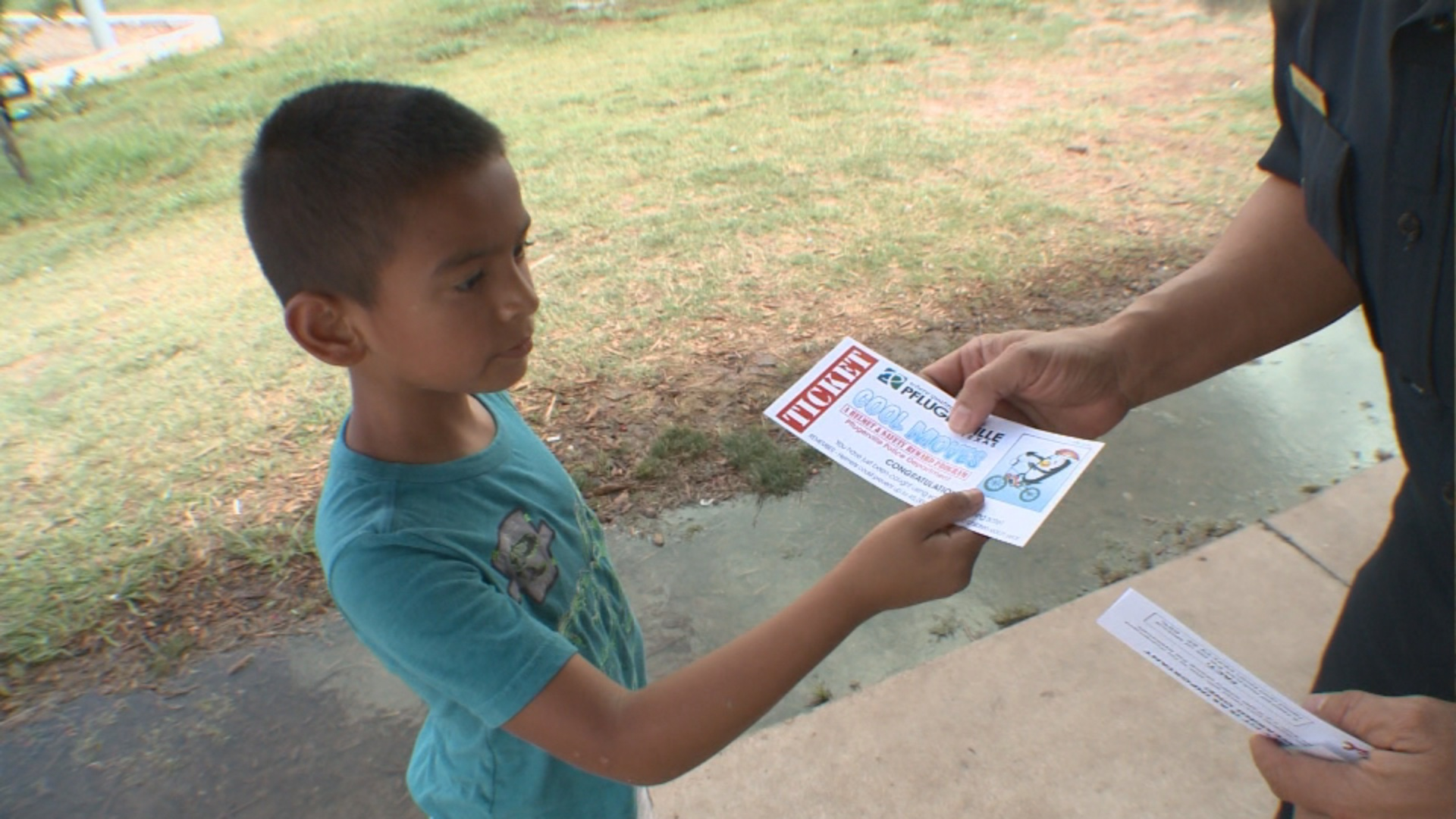 Pflugerville Police Handing Cool Move Ticket to Child_484836