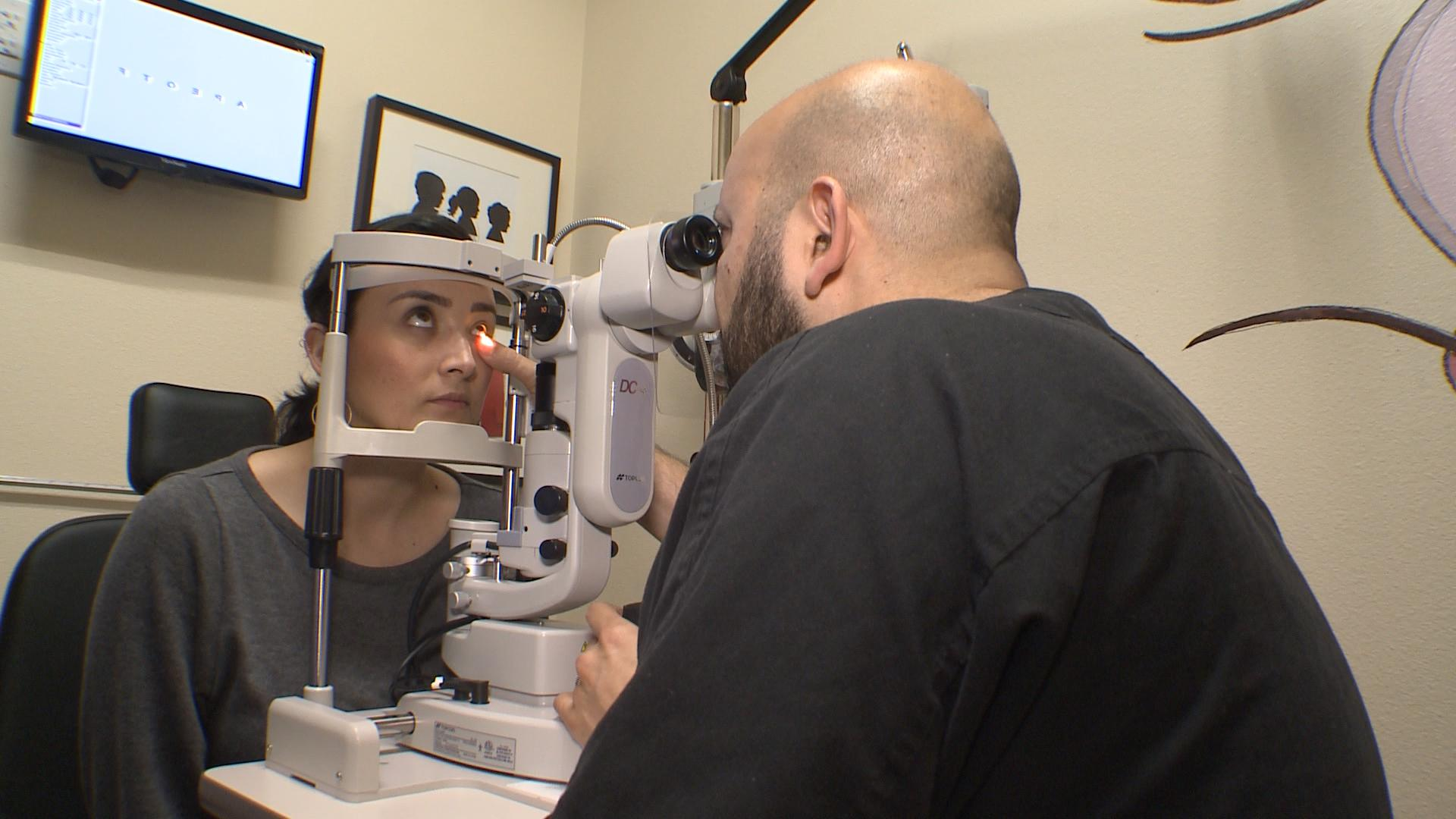 Doctor exams patient with Meibomian gland dysfunction
