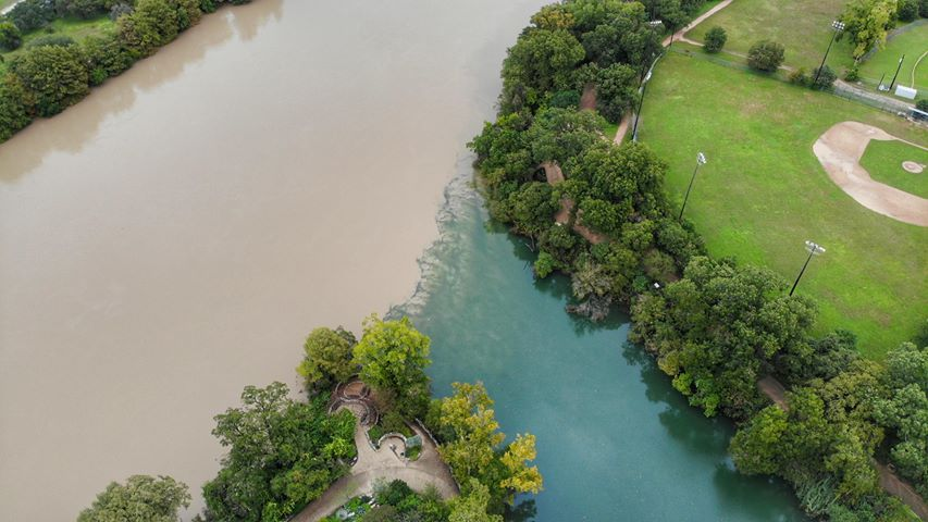 Muddy waters of Lady Bird Lake meet the clear waters of Barton Creek in Austin on Oct. 25, 2018