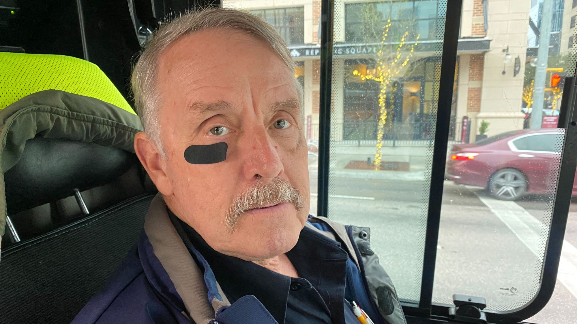 Cap Metro bus driver wears black bandage under eye