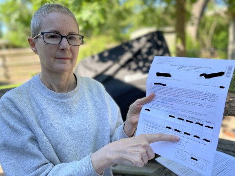 Lisa Martin shows the unemployment notice saying her husband would receive benefits of $  535 each week. The TWC later told the Martins the claim filed in his name was fraudulent. (KXAN Photo/Jody Barr)
