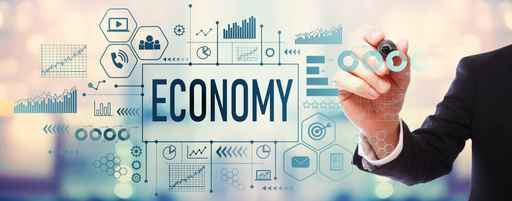 Economy with businessman on blurred abstract background_1556716538851