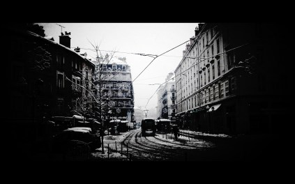 Near black and white retro view of actual modern Grenoble town with trawmway by Kyesos