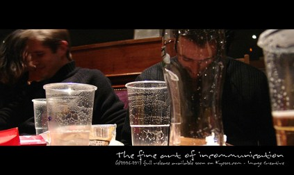 Isolation of a man in bar while other people are active
