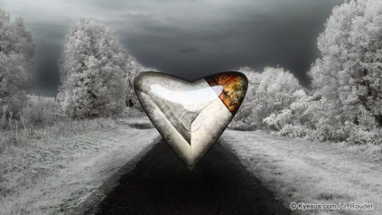 Metallic heart shape on a cold winter landscape
