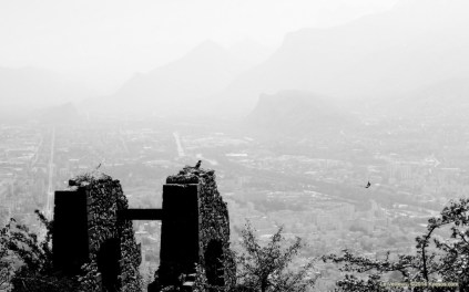 Dark bird watching over the valley by Kyesos