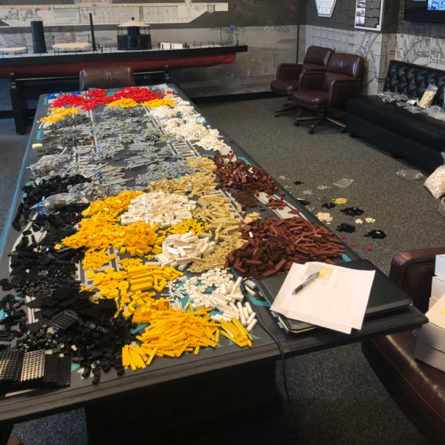 A large table covered with 14,000 LEGOs.