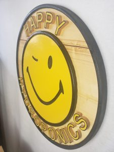Happy Hydroponics Sign, full view, 45 degrees, right