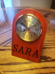 Padauk Desk Clock with name inlay, front view, rotated slightly left