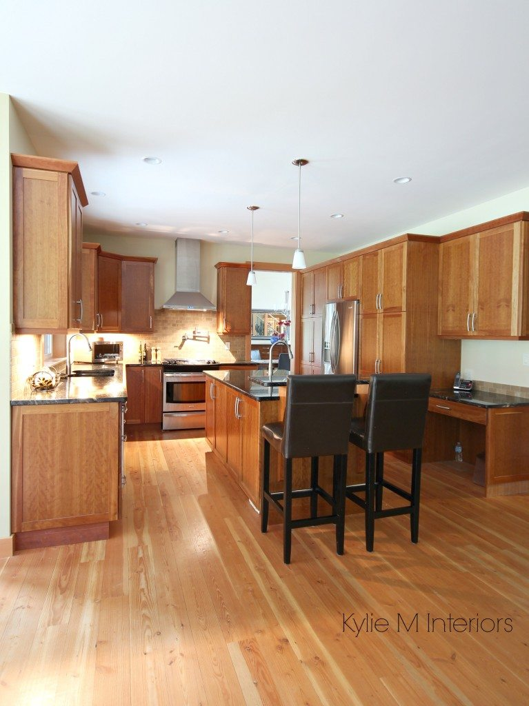 Kitchen with island natural cherry cabinet fir wood floori black granite island with raised