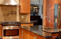 Natural cherry cabinets in kitchen with black granite