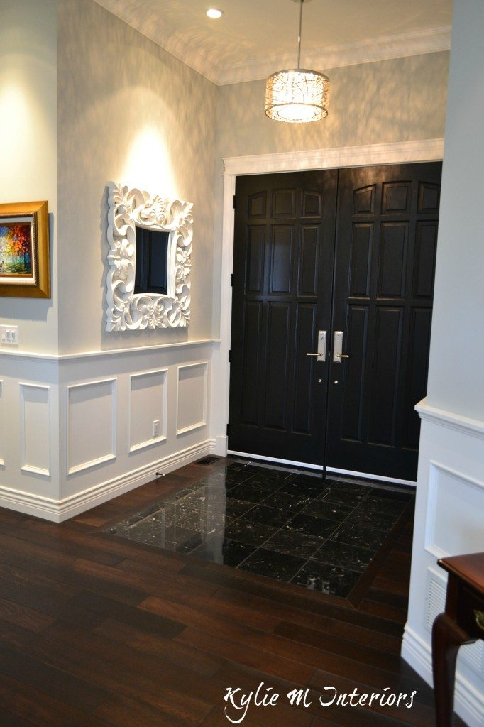 Black Marble Floor With Dark Wood Floor Wainscoting And