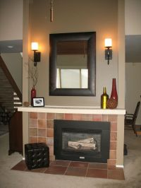 Vertical mirror above fireplace
