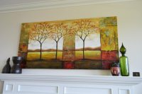 height to hang artwork above a fireplace mantle