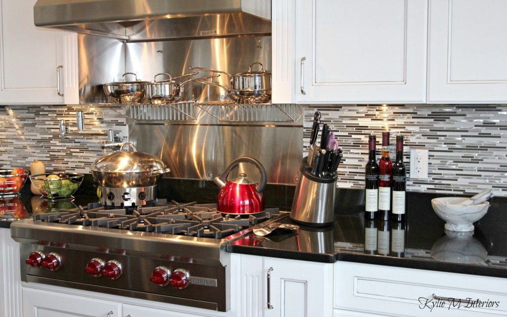 Beautiful Chefs Kitchen With White Glazed Cabinets Black