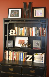 Decorating a bookshelf with books, accessories and artwork
