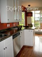 kitchen with white cabinets and red walls boxcar red by ...
