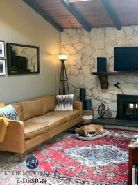 Stone wall fireplace in living room, vaulted wood ceiling ...