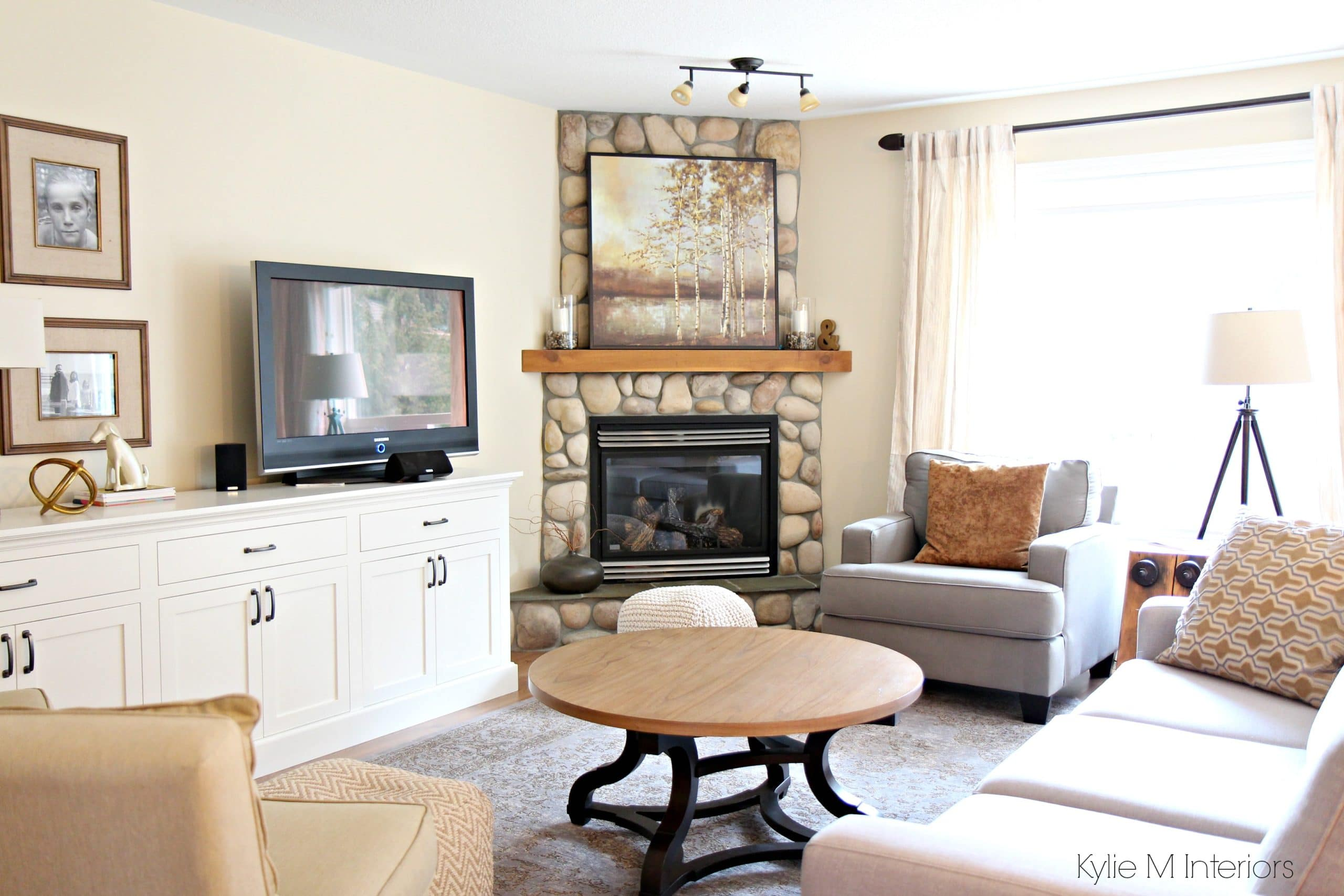 South facing living room with stone corner fireplace