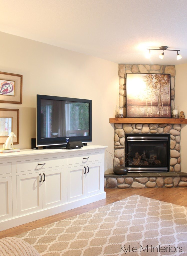 living room with corner stone fireplace Tv stand that