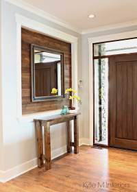 Alcove or niche in entryway wall clad in stained shiplap ...