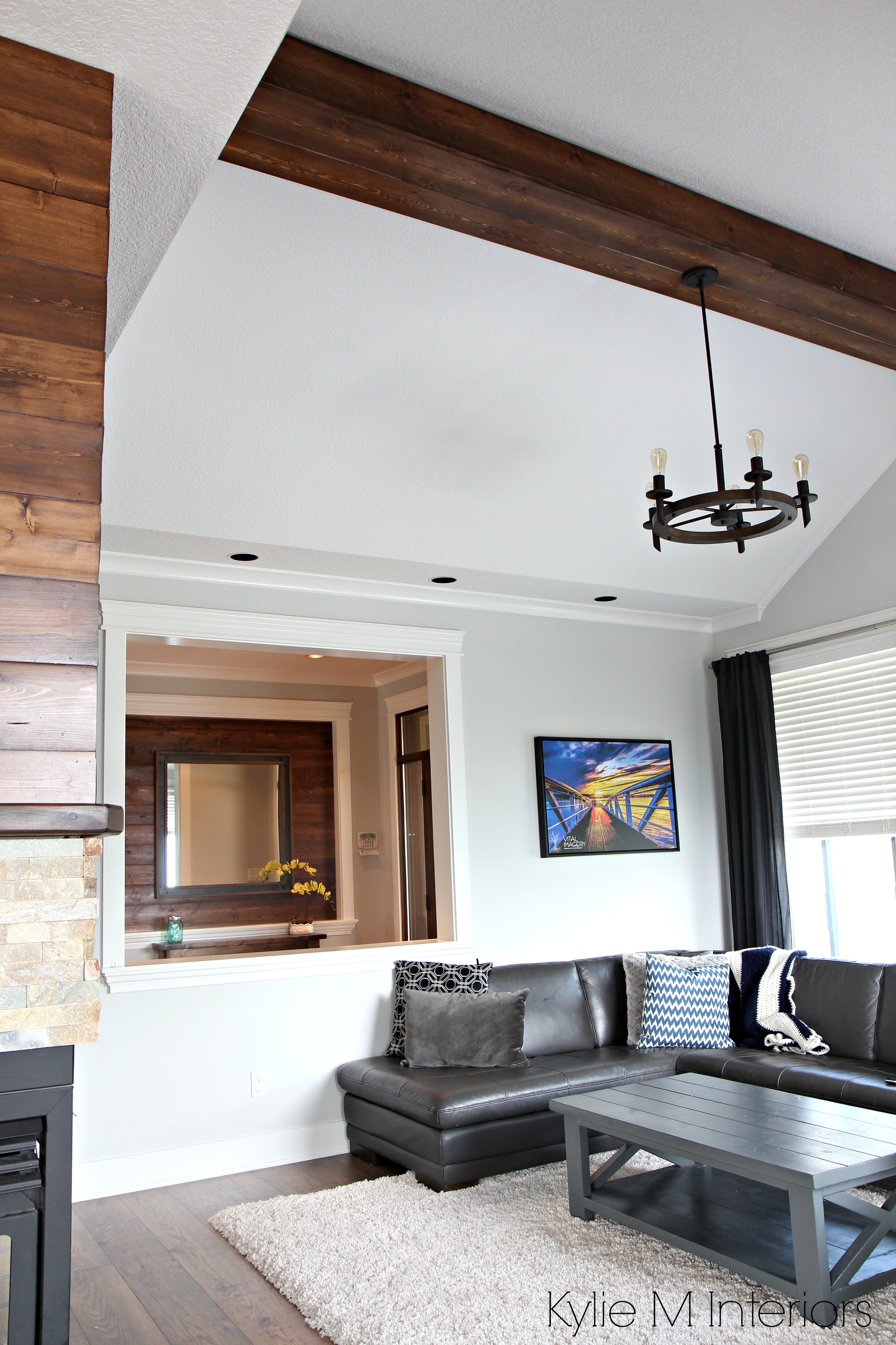 Living room design with vaulted ceiling, faux wood beam
